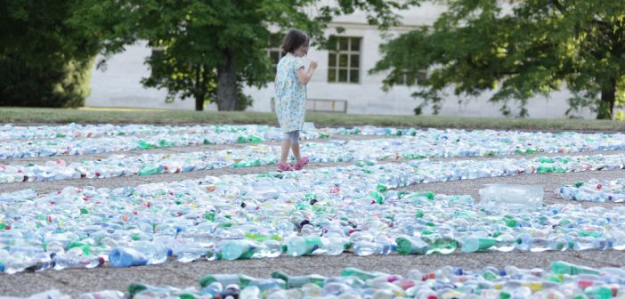 """A Child Explores """"Recycling Labyrinth"""" Art Installation at U.N. Office Geneva. Source: USA Mission to the UN in Geneva"""