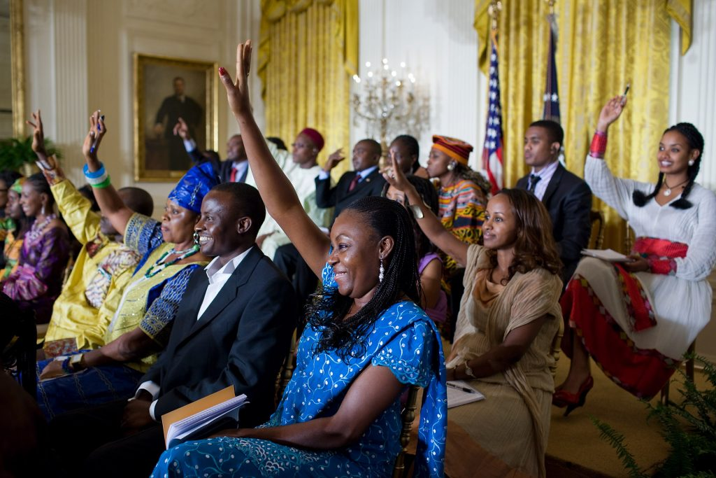 Participants raise their hands as President Barack Obama asks for questions during a town hall-style meeting with young African leaders in the East Room of the White House, Aug. 3, 2010.  (Official White House Photo by Pete Souza)